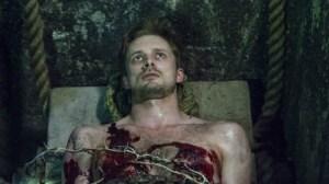 Damien in grave